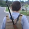 Man walks neighborhood with rifle,crime drops, anti-gun neighbor hysterical